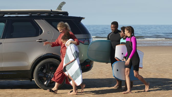 Land Rover Discovery with family