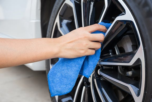 A car wheel being cleaned