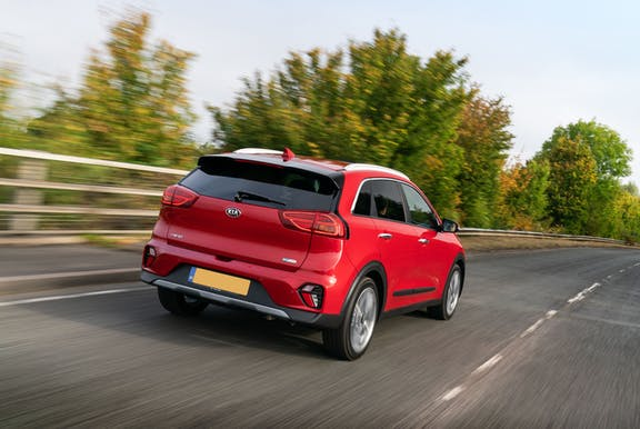 The rear exterior of a red Kia Niro