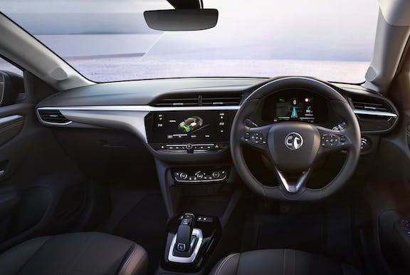 The interior of a Vauxhall Corsa with steering wheel and dashboard in shot