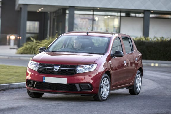 The front exterior of a red Dacia Sandero