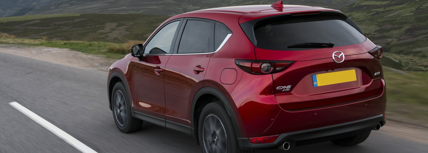 The rear exterior of a red Mazda CX-5