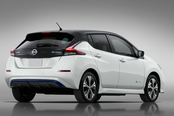 The rear exterior of a white Nissan Leaf