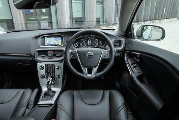 The interior of a Volvo V40 with steeringwheel and dashboard in shot