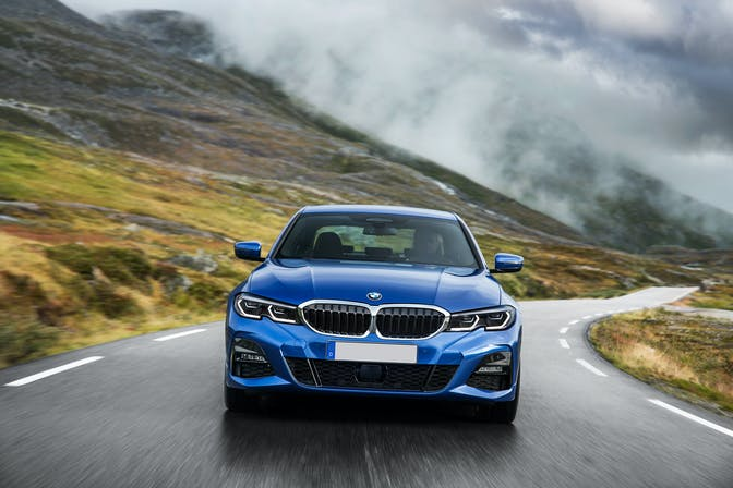 The front exterior of a blue BMW 3 Series
