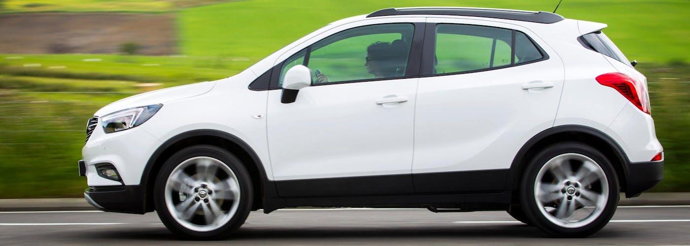 The side exterior of a white Vauxhall Mokka X
