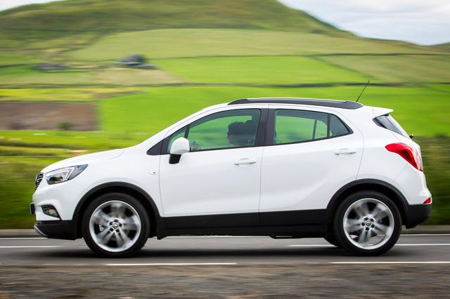 The side exterior of a white Vauxhall Mokka X