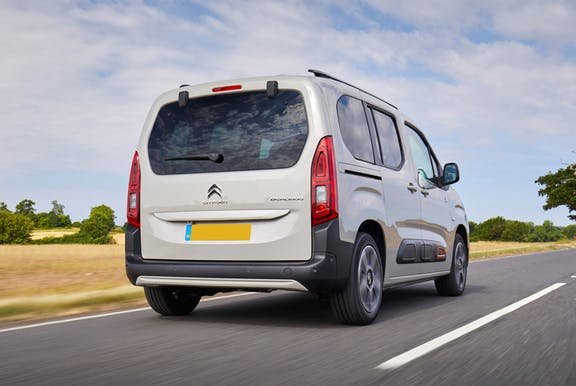 The rear exterior of a white Citroen Berlingo