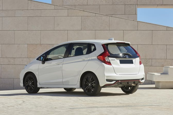 The exterior of a white Honda Jazz