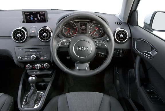 The interior of an Audi A1 with steeringwheel and dashboard in shot