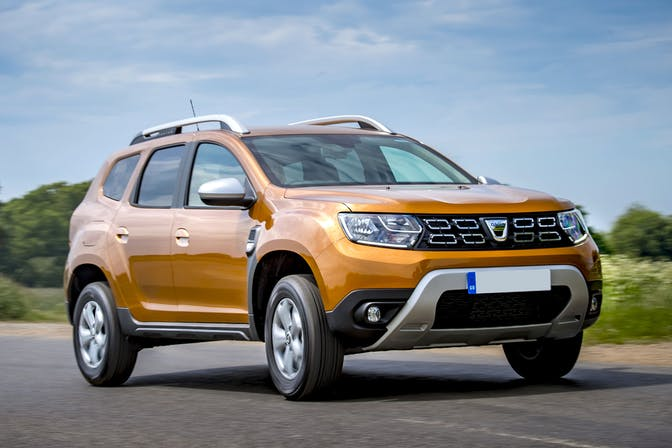 The exterior of a yellow Dacia Duster