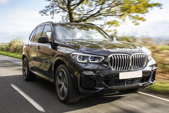 The exterior of a black BMW X5