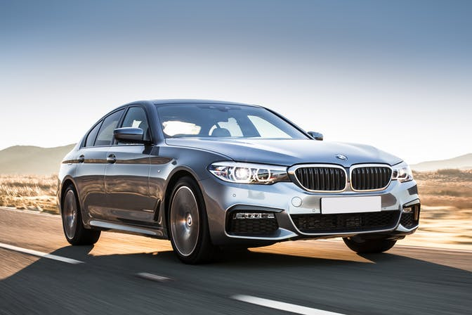 The front exterior of a silver BMW 5-Series