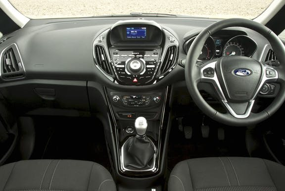 The interior of a Ford B-Max with steering wheel and dashboard in shot