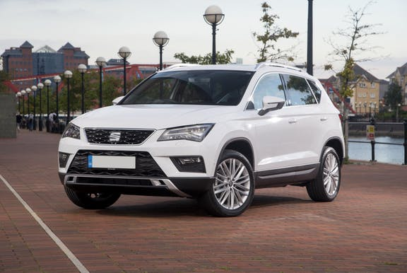 The front exterior of a white Seat Ateca