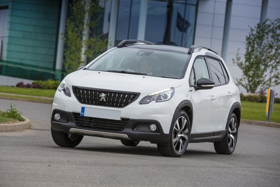 The front exterior of a white Peugeot 2008