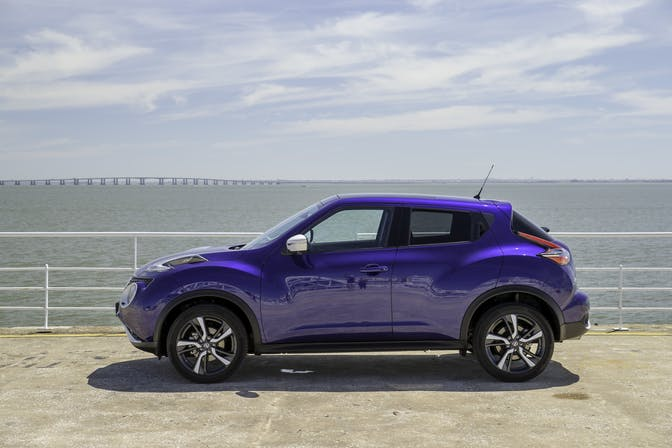 The side exterior of a blue Nissan Juke