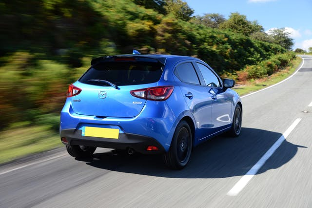 The rear exterior of a blue Mazda 2