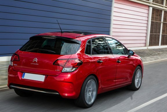 The rear exterior of a red Citroen C4