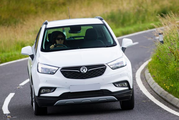 The front exterior of a white Vauxhall Mokka X