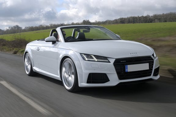 The front exterior of a white Audi TT Roadster
