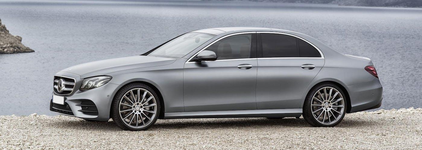 The side exterior of a silver Mercedes-Benz E-Class