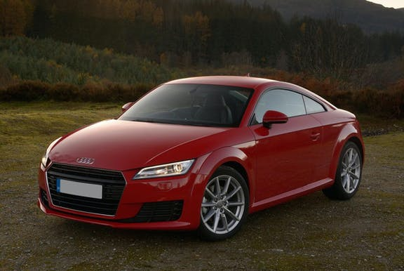 The front exterior of a red Audi TT