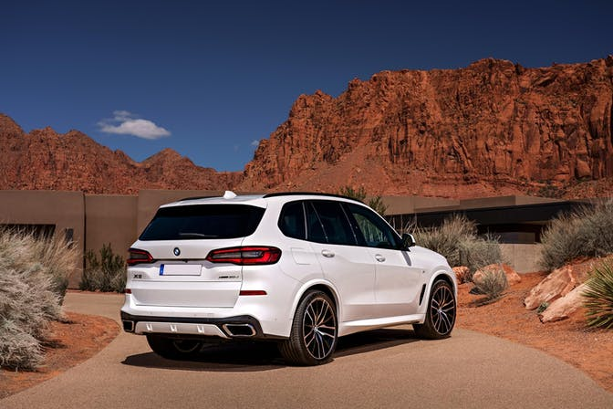 The rear exterior of a white BMW X5