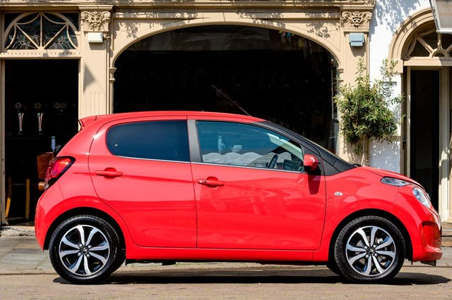 The side exterior of a red Citroen C1