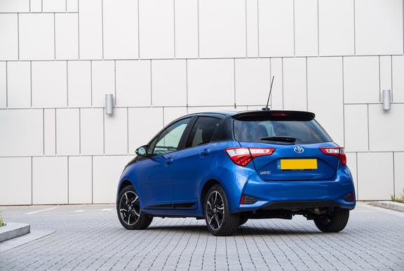 The rear exterior of a blue Toyota Yaris