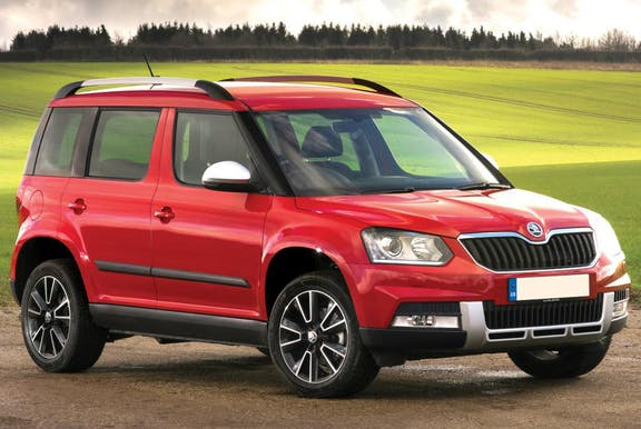 The front exterior of a red Skoda Yeti