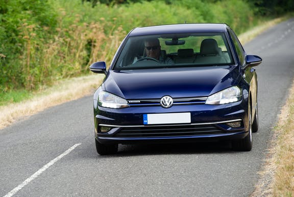 The front exterior of a blue Volkswagen Golf