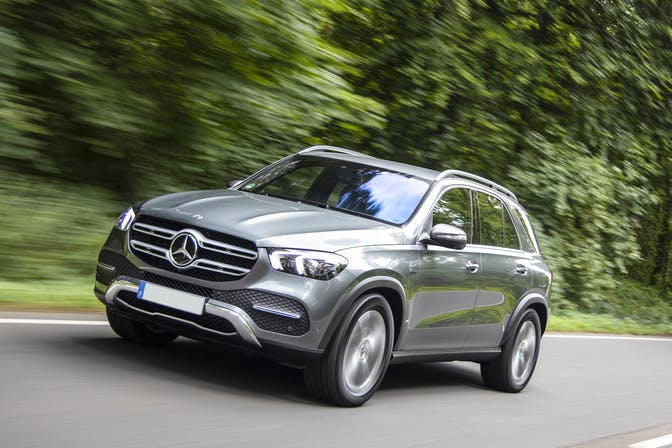 The front exterior of a silver Mercedes-Benz GLE