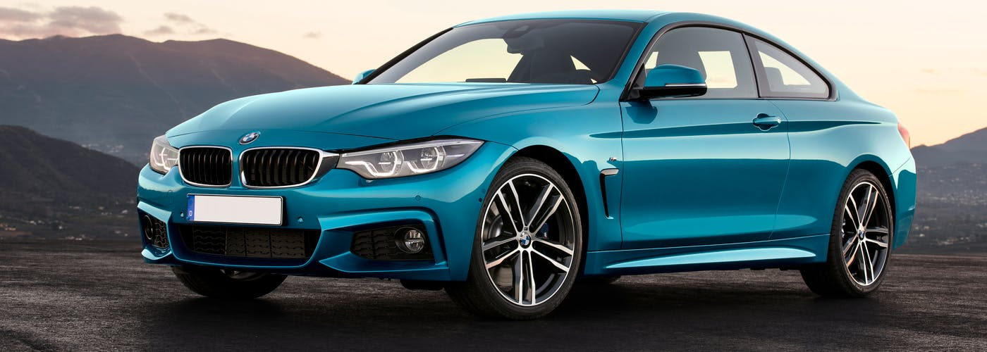The exterior of a blue BMW 4 Series