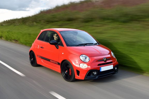 The front exterior of a red Abarth 595