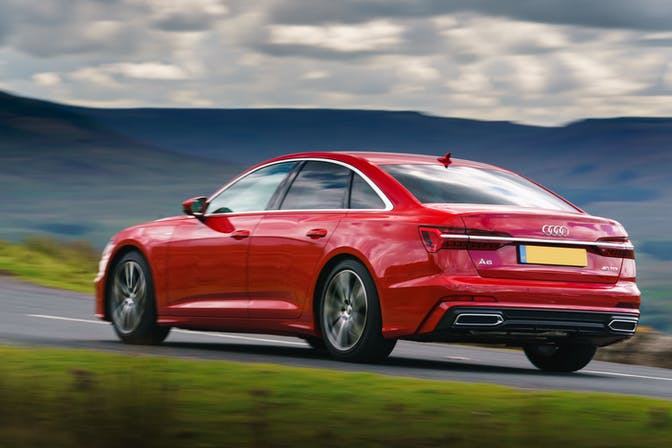 The rear exterior of a red Audi A6