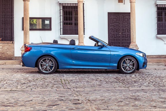 The exterior of a BMW 2-Series with roof down