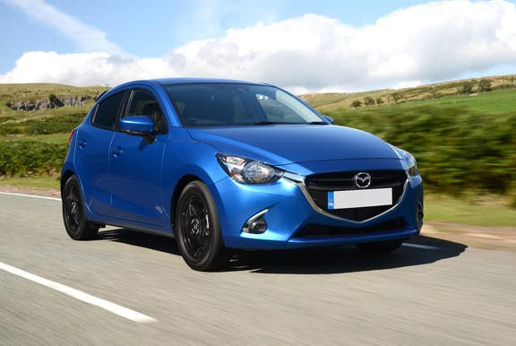 The front exterior of a blue Mazda 2