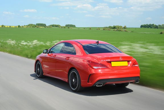 The rear exterior of a red Mercedes-Benz CLA
