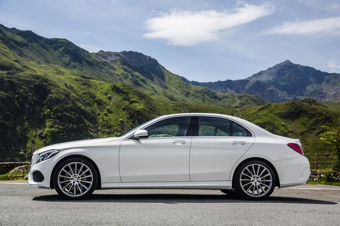 The side exterior of a white Mercedes-Benz C-Class