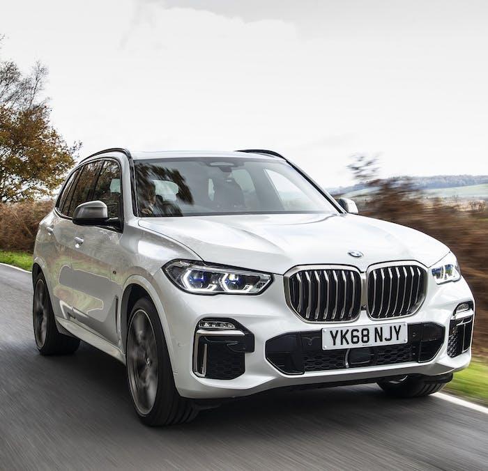 White BMW X5 M50d [2018] driving
