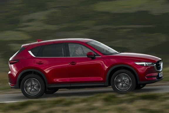 The side exterior of a red Mazda CX-5