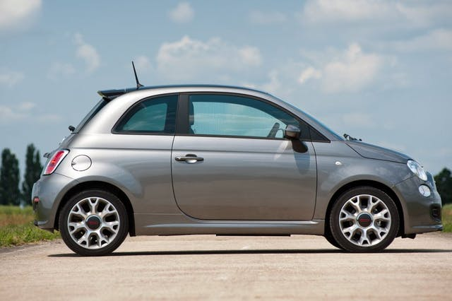 The side exterior of a silver Fiat 500