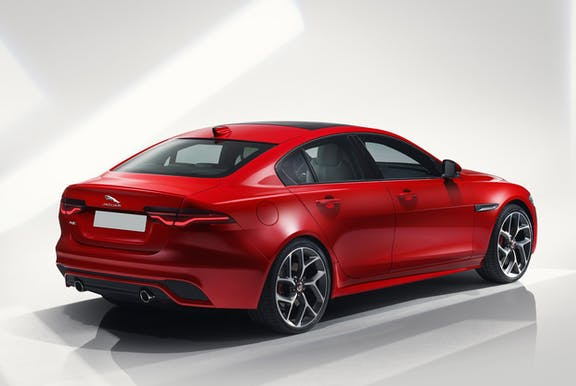 The exterior of a red Jaguar XE