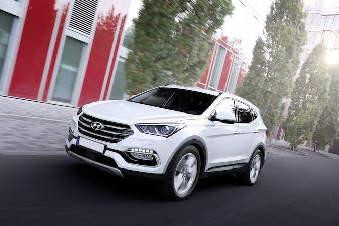 The front exterior of a white Hyundai Santa Fe