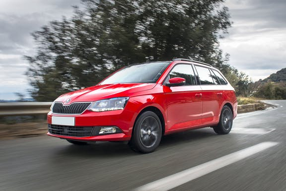 The front exterior of a red Skoda Fabia Estate