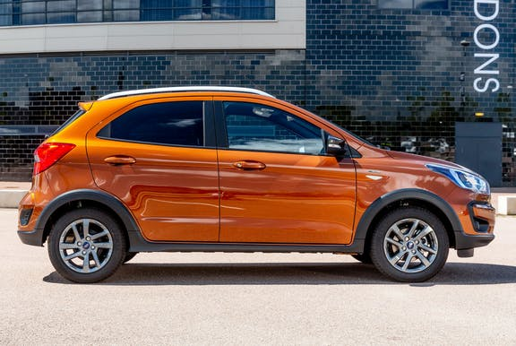 The side exterior of an orange Ford KA plus