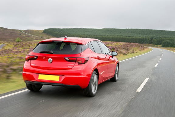 The exterior of a red Vauxhall Astra