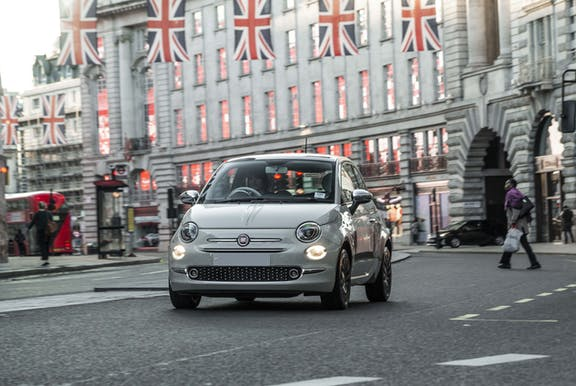 The front exterior of a white Fiat 500