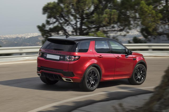 The rear exterior of a red Land Rover Discovery Sport